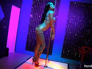 Romi Rain gets ultra-kinky on the stripper pillar