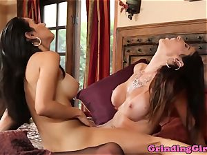 Stockinged lesbos scissoring before oral