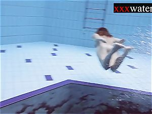 Smoking red-hot Russian redhead in the pool