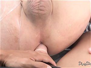 Dana mistreats her fellow with a immense dildo